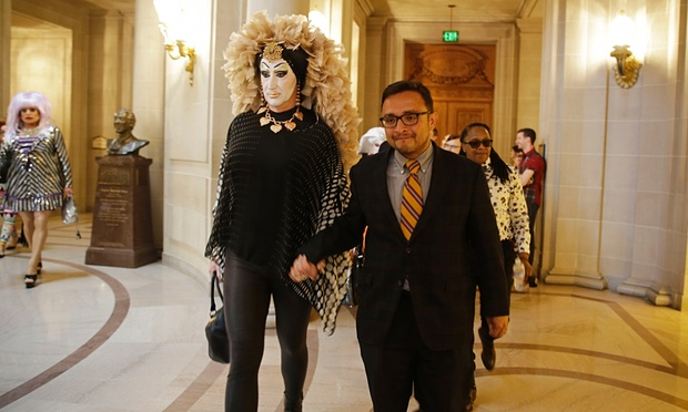 San Francisco supervisor David Campos, right, walks with Sister Roma after a meeting in his office with drag queens last month